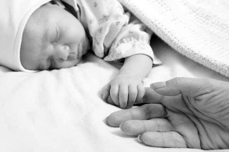 New born baby girl peacefully sleeping photo