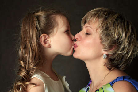 Portrait mum with a daughter in studio Stock Photo - 8790404