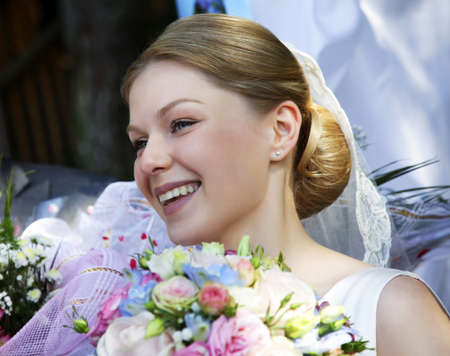 Portrait of the beautiful bride in a veil photo