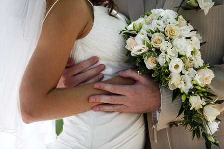 The groom and the bride with a wedding bouquet photo