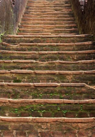 Stone ladder to a royal bedroom ancient Sri Lankan rock fortress of Sigiriya is a UNESCO World Heritage Site. photo