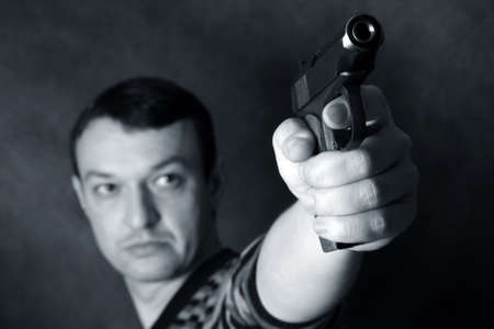 The man with a pistol on a background Stock Photo - 9568583