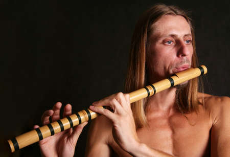 musicality: A man playing his wind instrument with expression