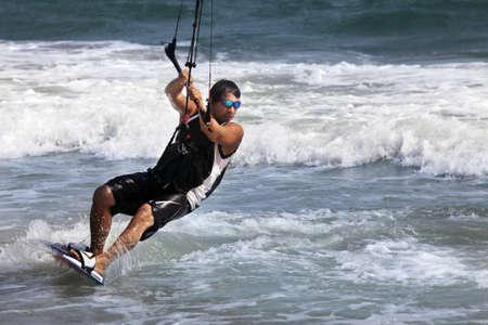 Kiteboarder enjoy surfing in ocean. Vietnam photo