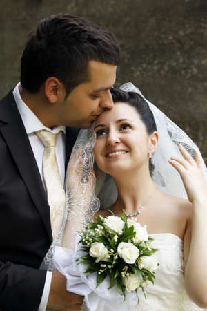 Newly-married couple in park Stock Photo
