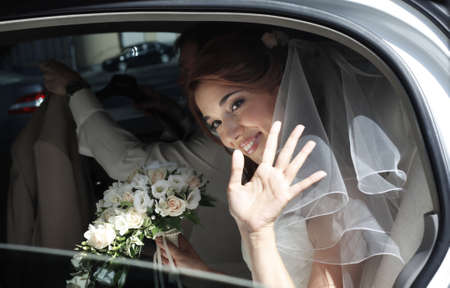 getting married: Beautiful bride in car Stock Photo