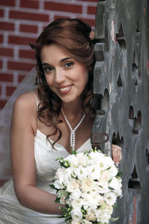 elation: The beautiful bride with bouquet in park