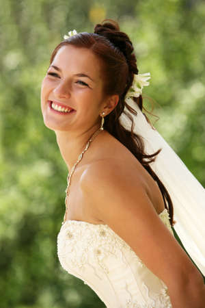 The beautiful bride on a green background Stock Photo - 10378757