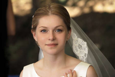 the beautiful bride on a dark background photo