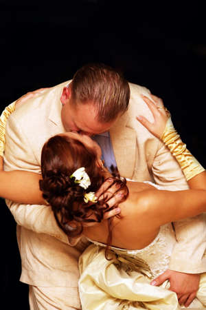 The groom and the bride kiss in dance photo