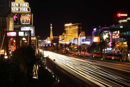 LAS VEGAS - SEPTEMBER 19: Las Vegas strip skyline and street scene at night on September 19, 2011 in Las Vegas, Nevada.
