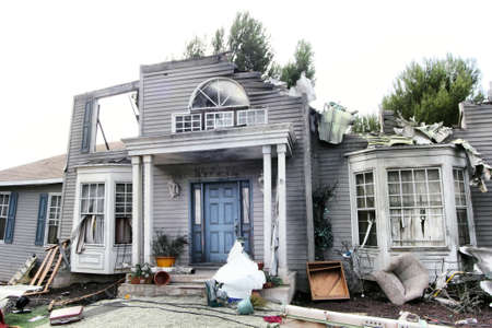 destroying: House damaged by disaster. Scenery for cinema