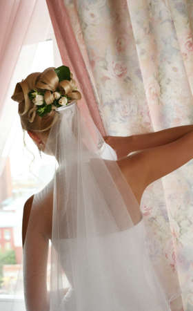 getting married: The bride at a window expects the groom Stock Photo