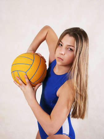 The girl - teenager in a water ball in studio photo