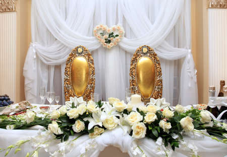 Table set for wedding dinner decorated with flowers photo