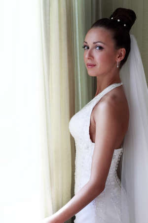 getting married: The beautiful bride at a window. Natural illumination