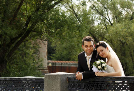 Newly-married couple in park photo