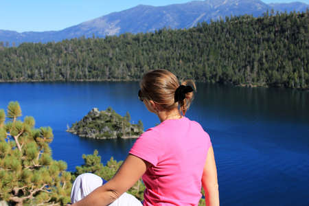 fannette: The girl sits on a coast of Lake Tahoe
