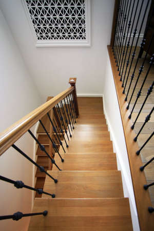 The wooden ladder conducting on the second floor