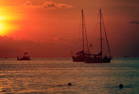 Sailing boats on a background of a beautiful sunset. Malaysia Stock Photo - 12723421