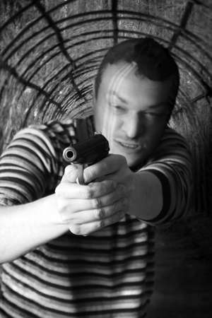 Black dressed man with gun in the tunnel photo