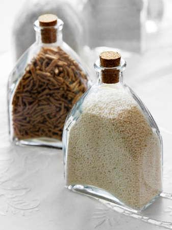 distinctive flavor: Two glass bottles filled groats