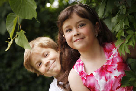 Brother and sister outdoors smiling photo