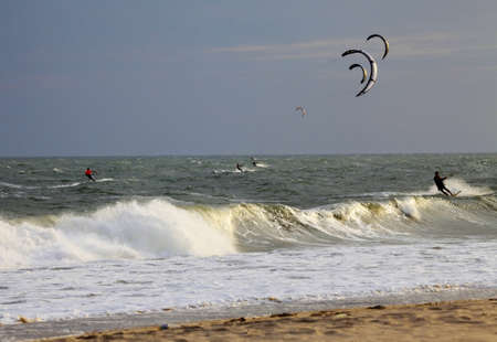 Kiteboarders enjoy surfing in ocean  Vietnam Stock Photo - 13864778