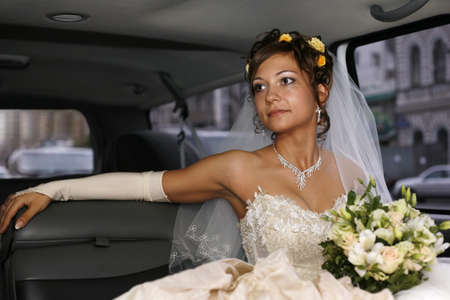 Portrait of beautiful happy bride in car Stock Photo - 13862207