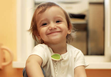 kids hugging: The small happy girl at home