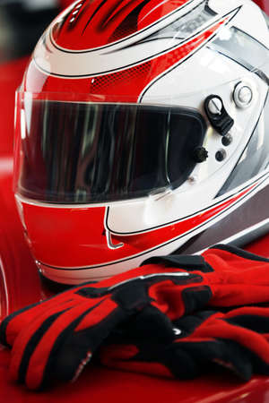 motorcycle helmet: Red helmet and gloves for sports Stock Photo