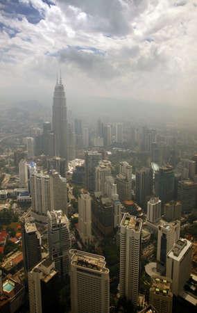 cloud scape: Office at Petronas Twin Towers at Kuala Lumpur, Malaysia. Stock Photo