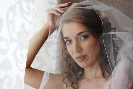 elation: Portrait of the beautiful bride with natural illumination