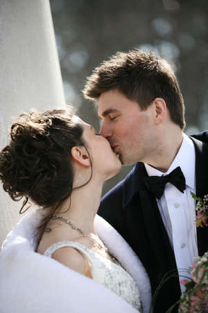 descendants: The groom and the bride kiss Stock Photo