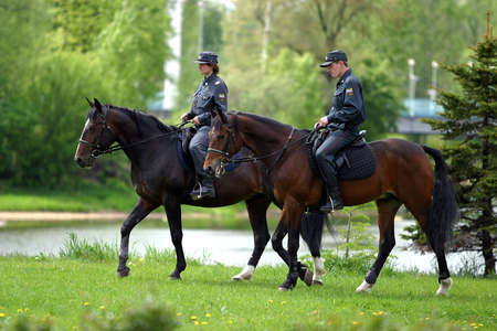 june 25: RUSSIA, MOSCOW - JUNE 25: Mounted police in a park in June 25, 2007 in Moscow, Russia
