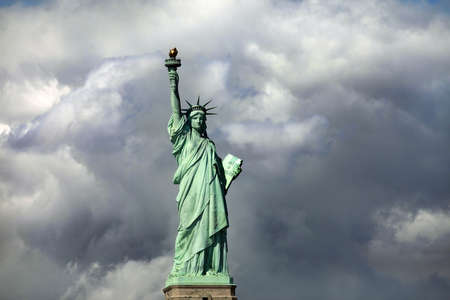 Statue of Liberty on Liberty Island in New York City. - isolated on blue sky background Stock Photo - 16372411