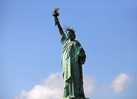 Statue of Liberty on Liberty Island in New York City. - isolated on blue sky background