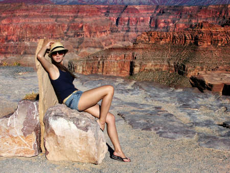 The beautiful young girl at the end of midday in the Grand Canyon Arizona photo