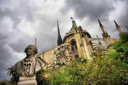 Notre Dame de Paris and a sculpture Carlo Goldoni. France Stock Photo - 16860437