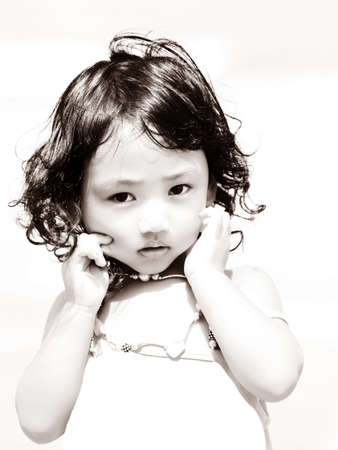 charms: Portrait of the beautiful small Asian girl  Indonesia  Java Stock Photo