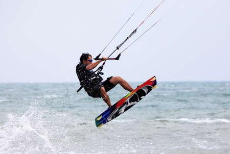 Kiteboarder enjoy surfing in water. Vietnam photo