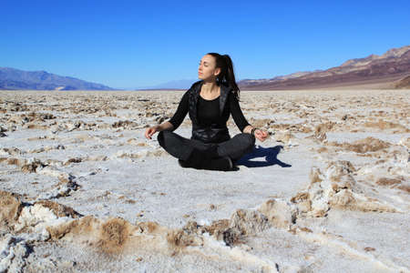 The beautiful girl sits in Bad water Salt lake at Death\ Valley