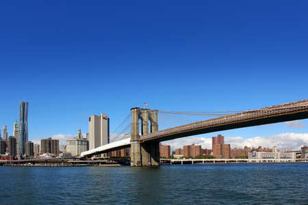 boroughs: View from East River of the Brooklyn Bridge and skyline in New York City, New York