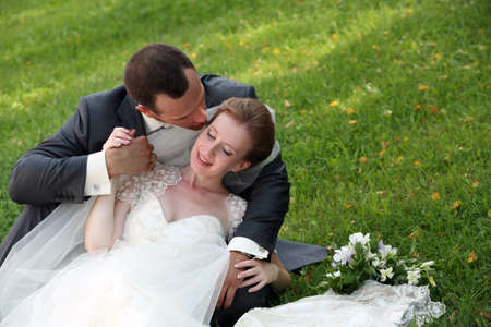 The groom and the bride kiss having closed by a veil Stock Photo - 17632246