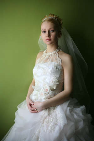 Beautiful bride in dress with flowers photo