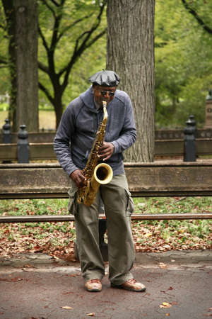 NEW YORK CITY - OCTOBER 9: A saxaphonist busking in Central Parks Bethesda Terrace, a popular tourist attraction October 9, 2012 in New York, NY.