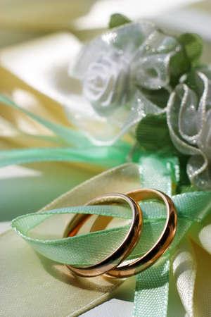 satiny: Wedding rings on a blue satiny fabric Stock Photo