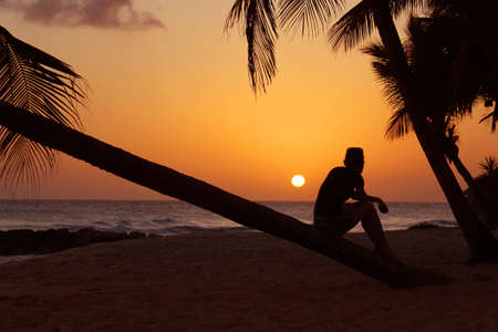barbados: Sunset on the beach with a girl