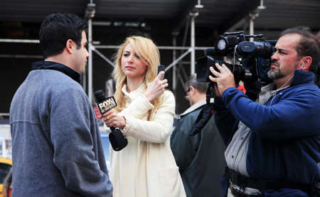 NEW YORK CITY - MAY 16  Journalists Fox Business News interview on Times Square May 16, 2013 in Manhattan, New York City