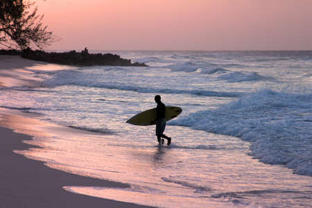 bodyboarding: Man-surfer with board on a coastline. Bali. Indonesia Stock Photo